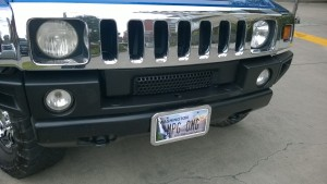 GMC Hummer with license plate OMG MPG